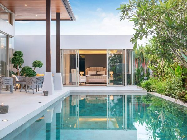 home-or-house-exterior-design-showing-tropical-pool-villa-with-green-garden_t20_Yww1LW
